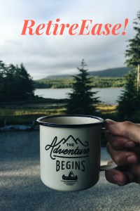 hand holding mug that reads the adventure begins