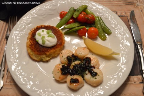 Scallops with Black Garlic Served with Potato Cake and Vegetables