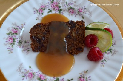 Plum Pudding Served with Buttered Rum Brown Sugar Sauce