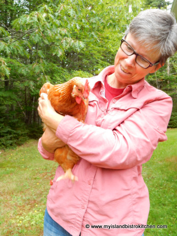 Shirley Gallant with one of her rented chickens from Barnyard Organics