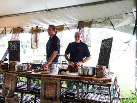 """Chefs Michael Smith and Paul Rogalski Shucking Oysters at """"Taste of Georgetown"""" Event, PEI"""