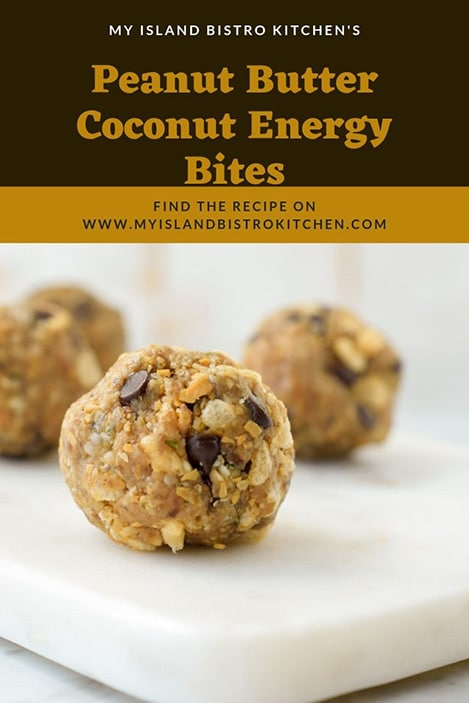 Close-up photo of Peanut Butter Coconut Energy Balls on white marble server