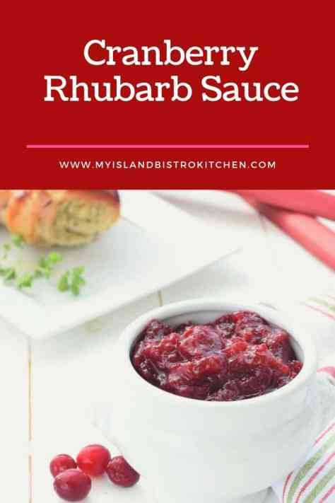 Bowl of Cranberry Rhubarb Sauce with Stuffed Rolled Turkey Breast in background
