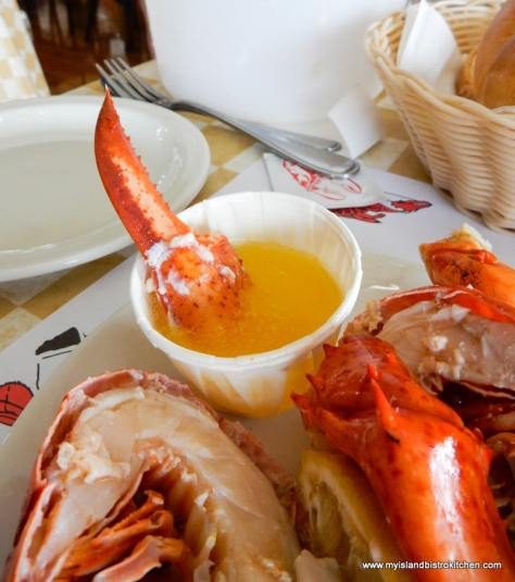 Dipping lobster claw in melted butter