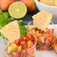 Small individual glasses filled with Fresh Peach Salsa