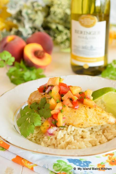 Peach Salsa tops roasted chicken breast served on a bed of steamed rice