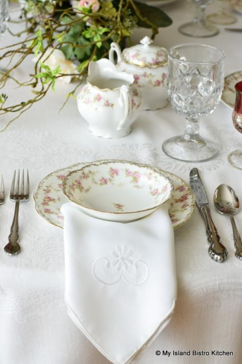 Placesetting with antique dishes with a pink and white design