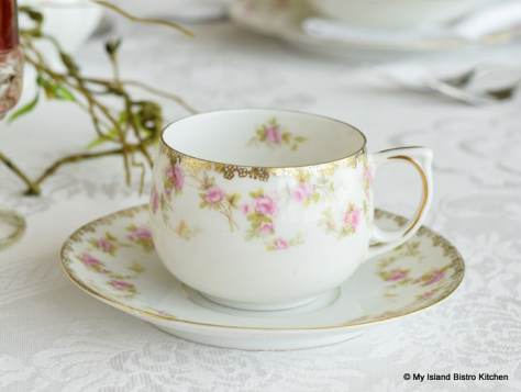 White cup and saucer with pink flowers and gold trim