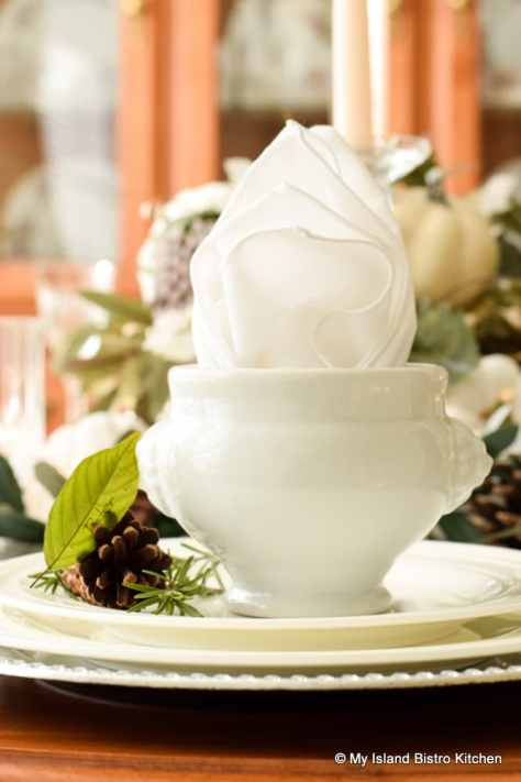 Miniature white soup tureens make ideal soup bowls and holders for the napkin