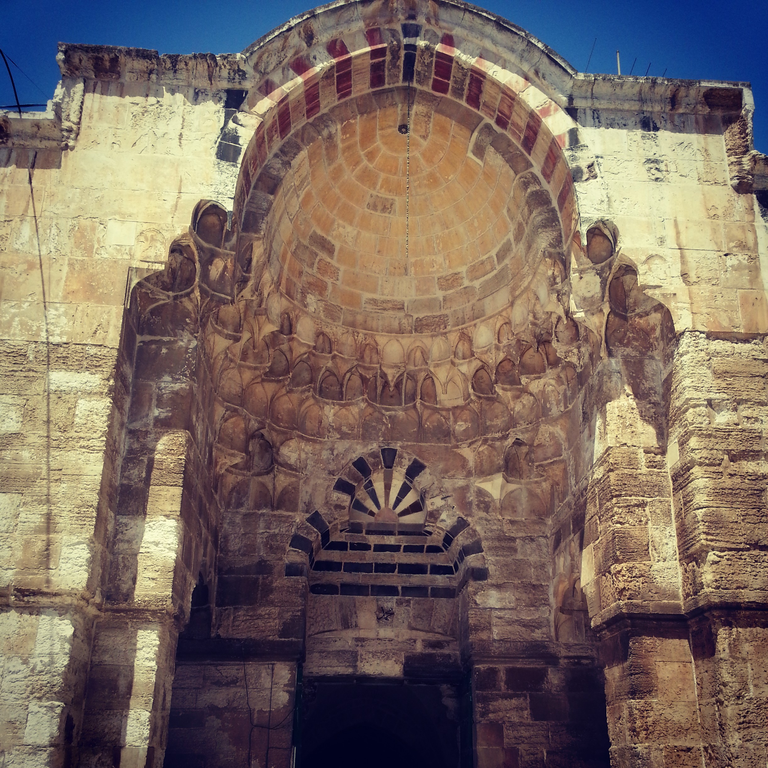 Mamluk architecture: note the alternating dark and light stone in the ablaq style