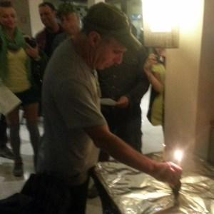 Our infamous course coordinator Benny lights the chanukkiah