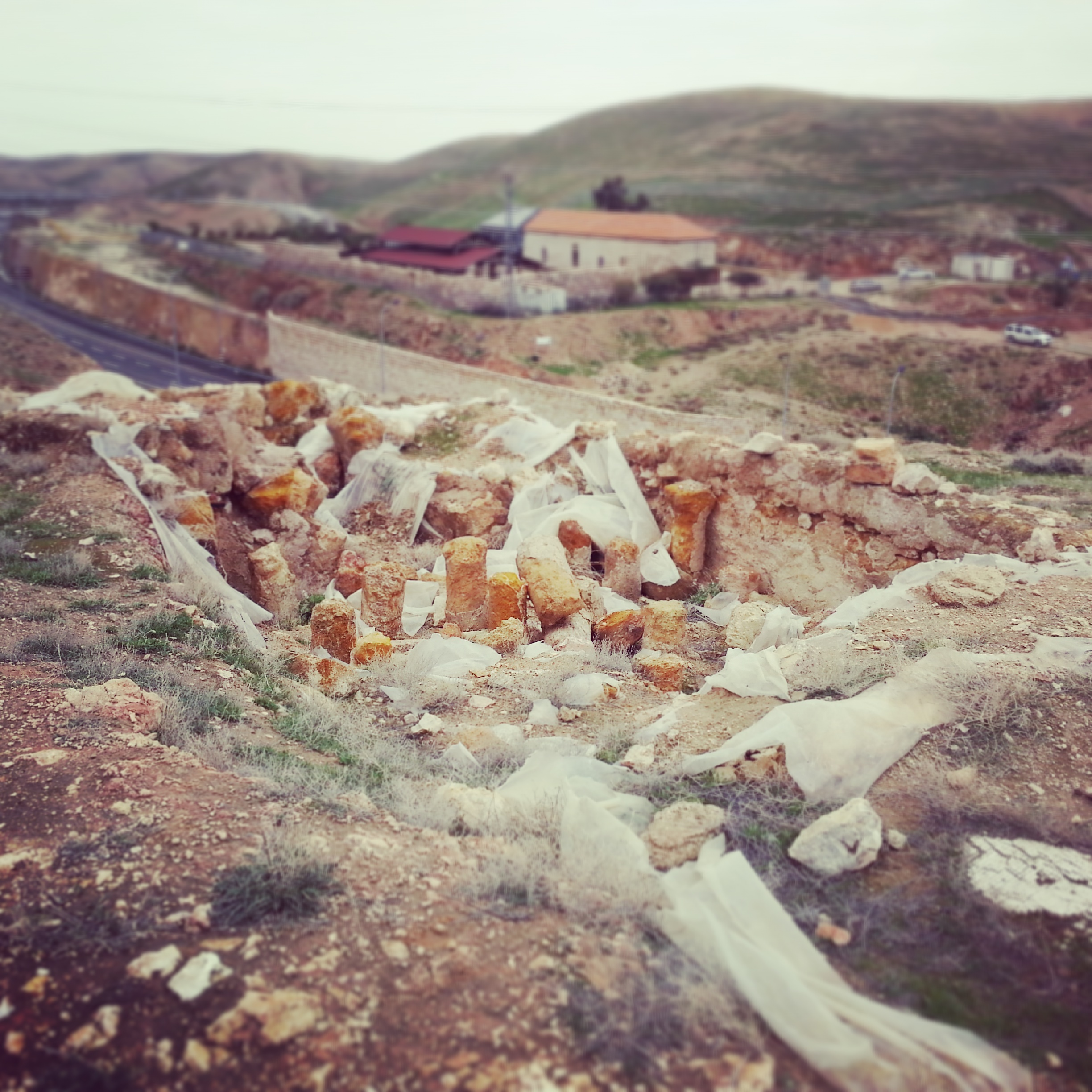 Remains of a Herodian bath house - in the background is Route 1 and the Inn of the Good Samaritan