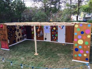 The Well decided to build its inaugural Sukkah out of reclaimed doors from the City of Detroit, and to decorate it in tribute to the Heidelberg Project!