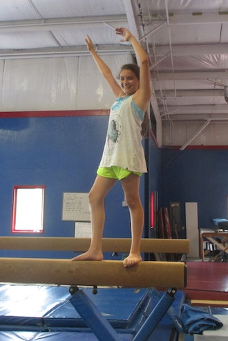 Alayna Matta strikes a pose on the balance beam at Westosha Legacy Athletic Club (Gail Peckler-Dziki/The Report).