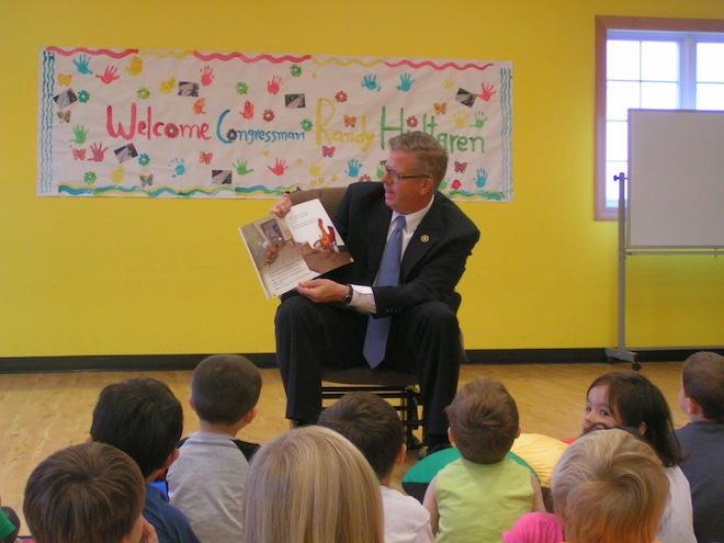 U.S. Congressman Randy Hultgren reads a book to children at A Child's Place Learning Center in Antioch Oct. 6 (Jason Arndt/Ill. Hi-Liter)