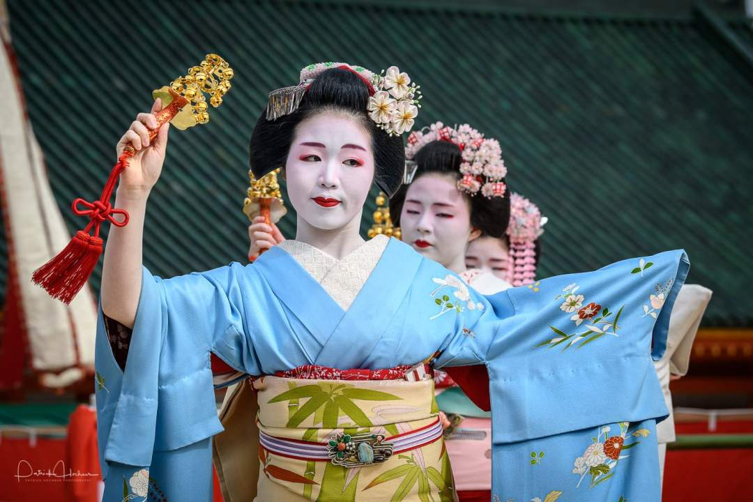Maiko Tomitsuyu of Gion Higashi dancing at the Heian Shrine Reisai Annual Festival, Kyoto