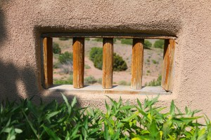 Typical New Mexico image of stucco with a wooden rail window.