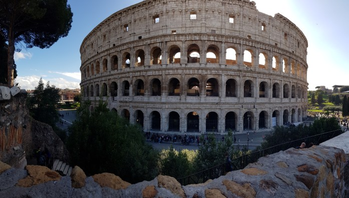 A panoramic view of the Colosseum in Rome. The outside edge where the