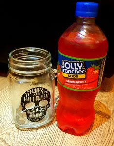 A picture of the Jolly Rancher Strawberry soda in the Trying American Sodas blog post for My Lavender Tinted World
