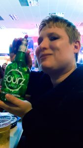 A picture of my mum with a bottle of Apple Sourz at the bonkers bingo event at Mecca Bingo in Sheffield