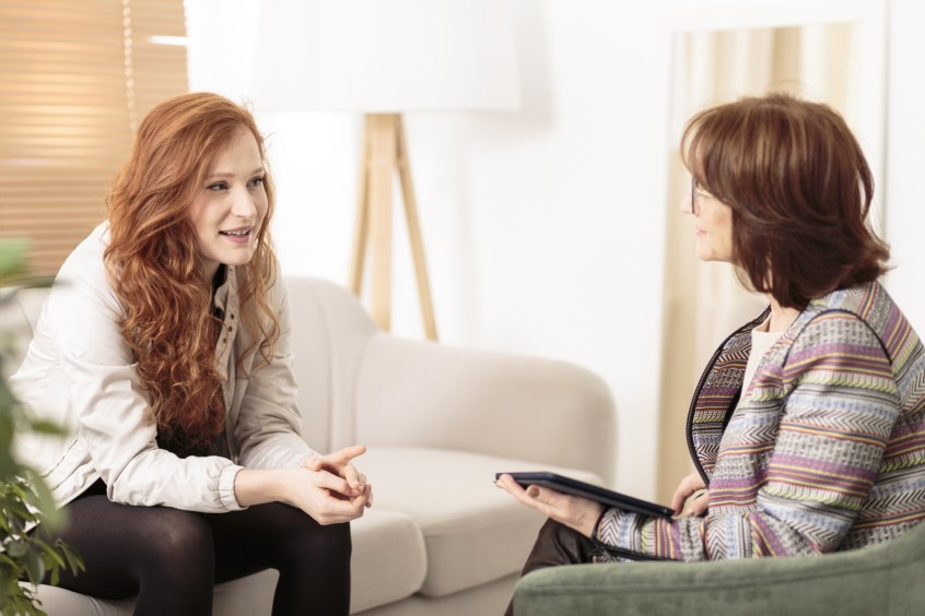 woman sitting with divorce coach