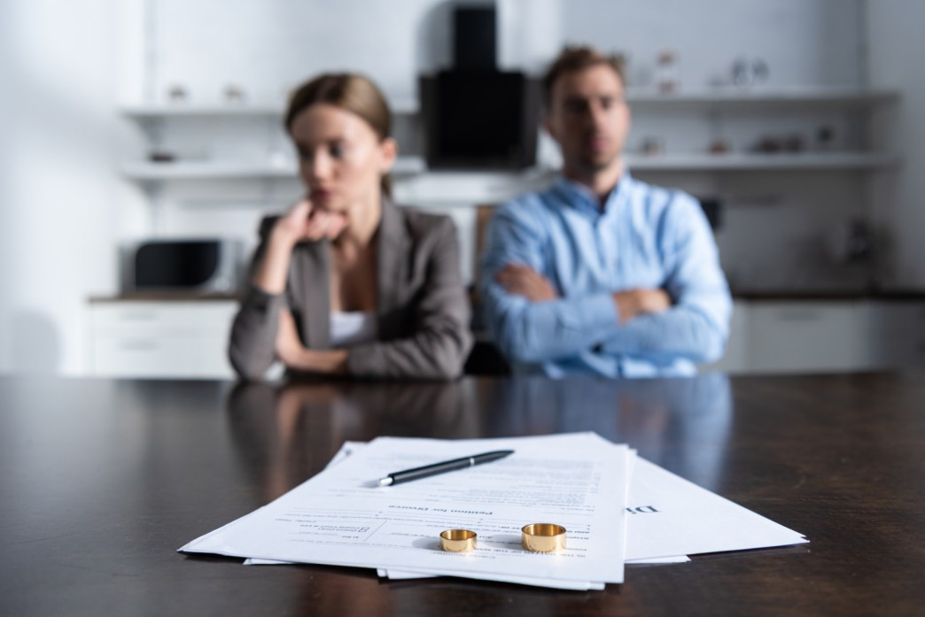 how long does an uncontested divorce take? | couple sitting with divorce papers