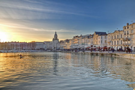 Old port of La Rochelle in a golden peaceful sunset, France