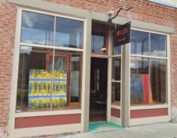 front of Myles Fine Art gallery in Salida, CO