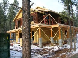 Myles Nelson McKenzie Design-Custom Square Log Mountain Home-Framing in the snow