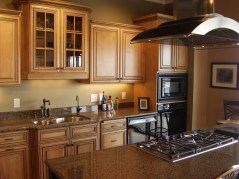 Myles Nelson McKenzie Design Design Construction Plans for Kitchen Remodels 2-Cinnamon Stain Cabinets, Black Appliances