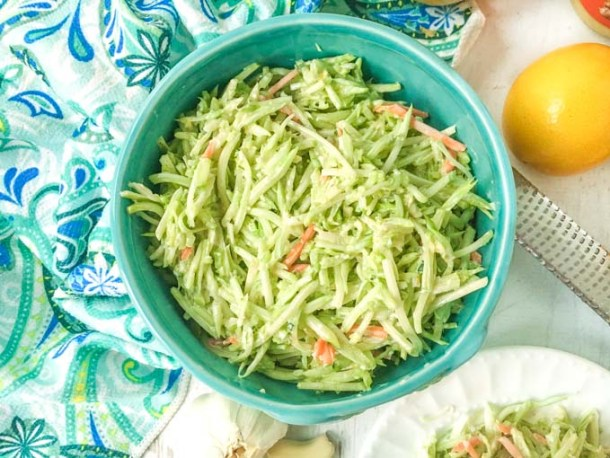 This low carb broccoli slaw is dressing a delicious creamy ginger dressing with lemon and garlic. It's a fresh and easy low carb salad that you can put together in 5 minutes and only has 4.3g net carbs!