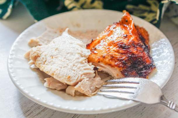 white plate with a serving of roasted turkey breast slices