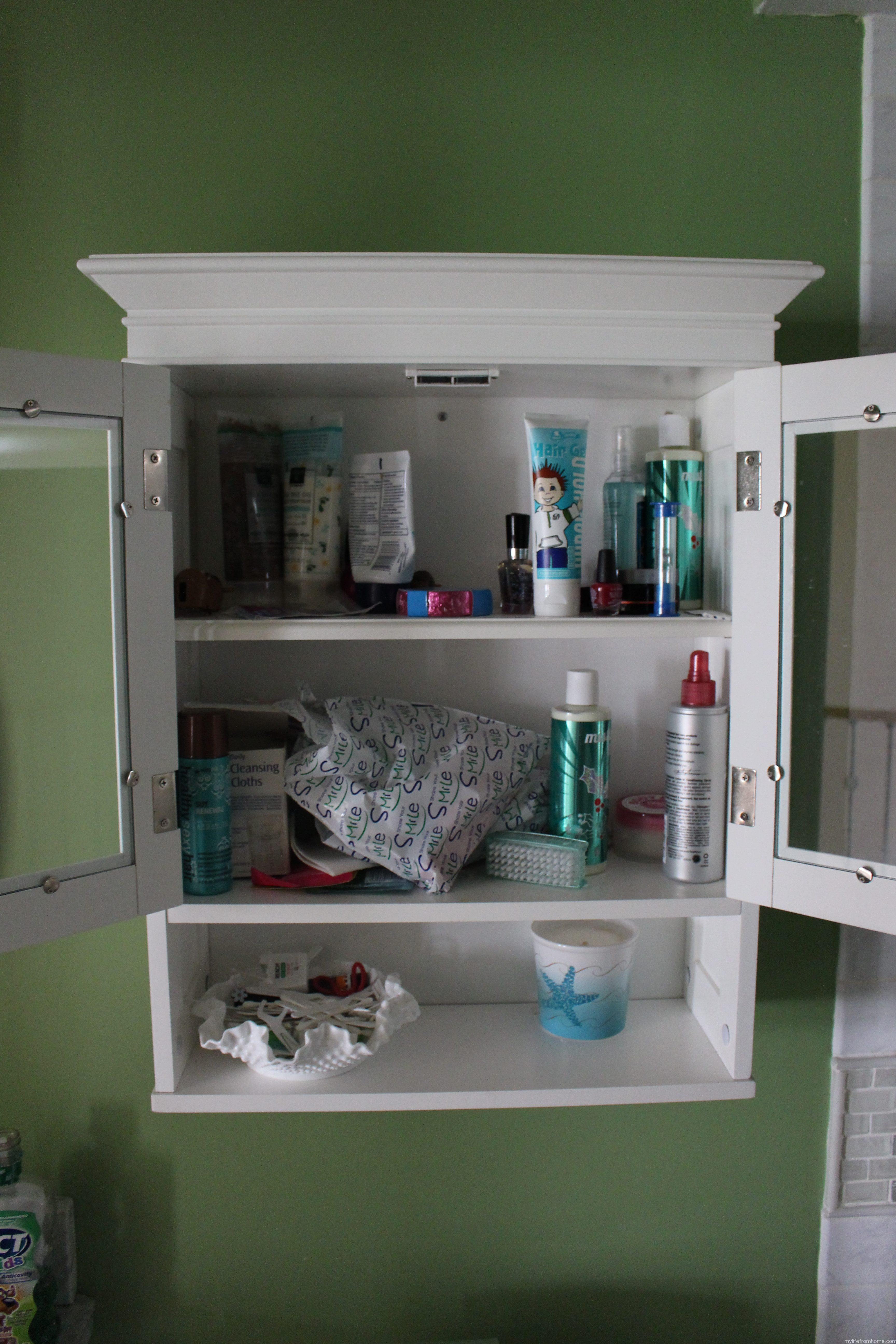 Overwhelmed Bath Cabinet by www.whitecottagehomeandliving.com