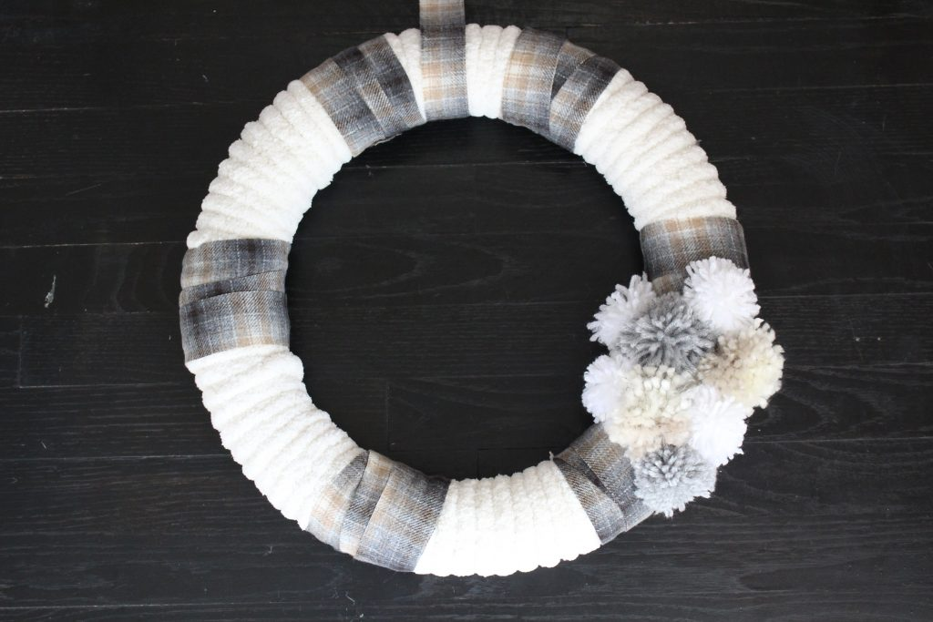 Winter White Holiday Wreath- crafts- diy- diy wreath- winter wreath- pompoms- pompom wreath- neutral wreath- winter decor- yarn wreath- diy- do it yourself project- pom pom wreath- handmade wreath