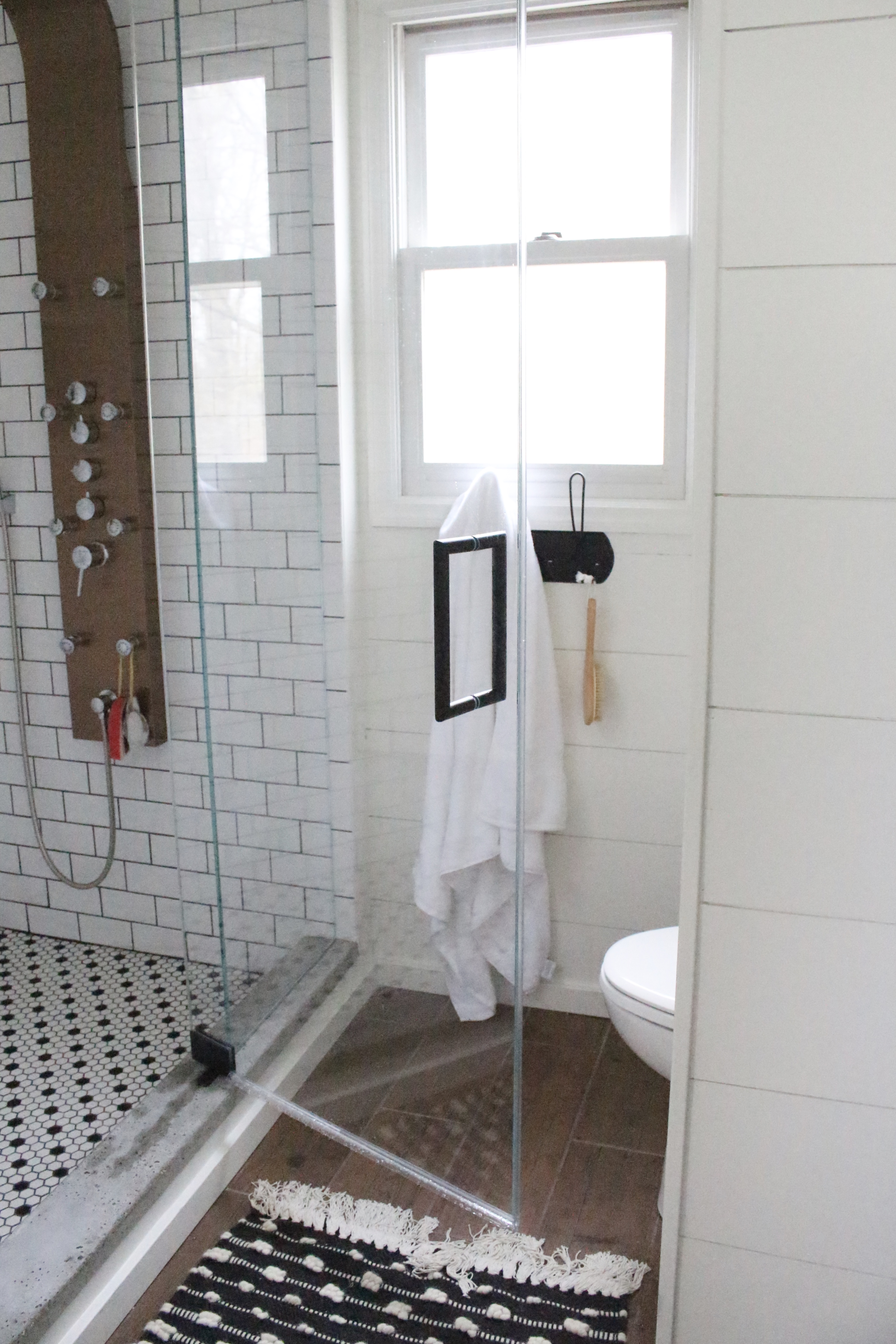Shower glass- bathroom renovation- master bathroom- subway tile- spa shower- copper accents- farmhouse style bath