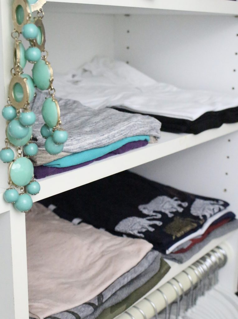 A full boutique closet reveal- master closet- closets- organizing closets- do it yourself- DIY- DIY projects- decoration ideas- room decor ideas- room design- home decor- closet decor- boutique- closet organization- shelf organization- walk in closet- folding t-shirts