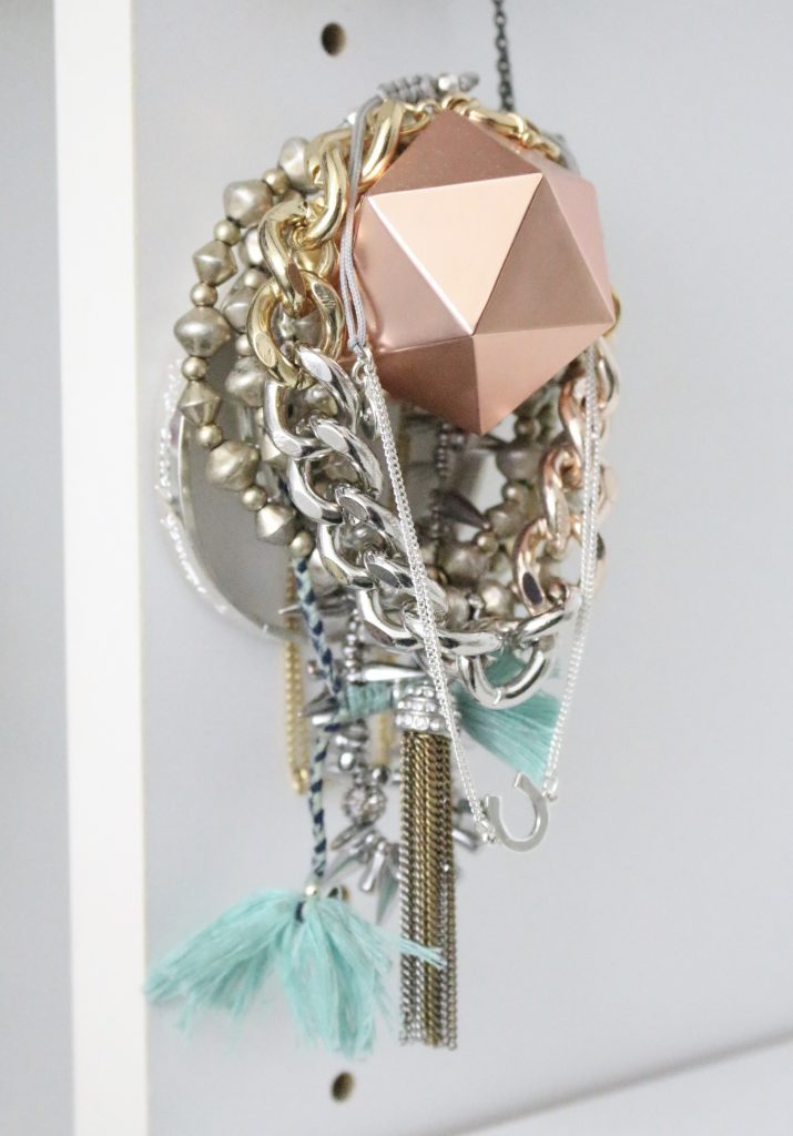 A full boutique closet reveal- master closet- closets- organizing closets- do it yourself- DIY- DIY projects- decoration ideas- room decor ideas- room design- home decor- closet decor- boutique- closet organization- shelf organization- walk in closet- jewelry storage- displaying jewelry in a closet- copper knobs