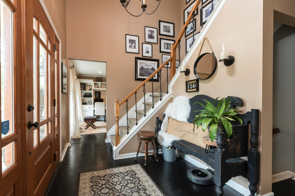 Whole House Tour- Photo by Justin Sheldon Photography- home design, room decor ideas- DIY- DIY projects- entryway- stairway with wrought iron railings- Do it Yourself- home decor- wall gallery- travel wall gallery