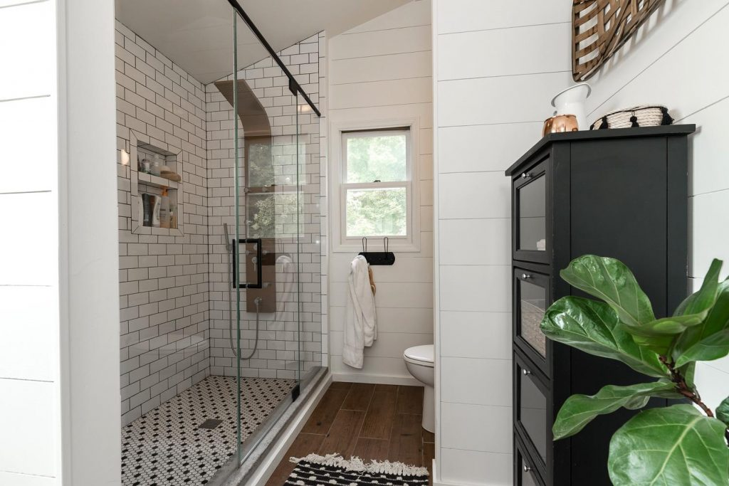 Whole House Tour- Photo by Justin Sheldon Photography- home design, room decor ideas- DIY- DIY projects- entryway- stairway with wrought iron railings- Do it Yourself- home decor- living space- farmhouse- family room- neutral decor- room decor ideas- decoration ideas- rustic home decor- bathroom- cement tile- copper lighting- wood and cement- bathroom- farmhouse bathroom ideas-subway tile- spa shower