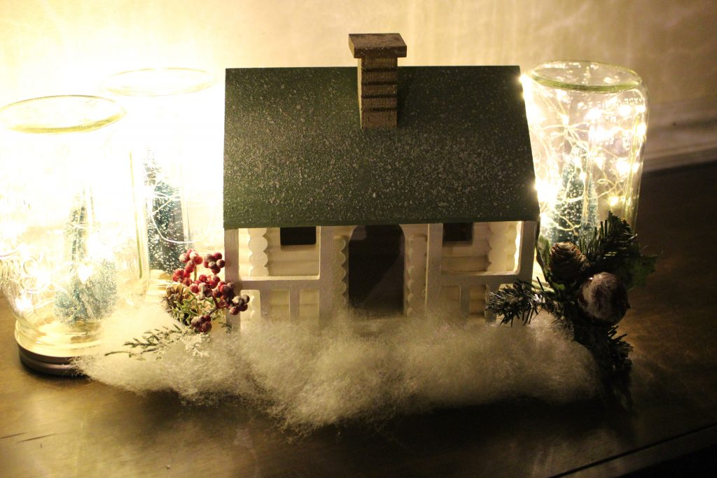 Wood log cabin- painted house- bristle bottle trees- Hobby Lobby- seasonal decor- winter- Christmas- diy- diy project- diy craft- rustic home decor- painted projects- home decor- snow village- twinkly mason jars- battery operated lights- fairy lights