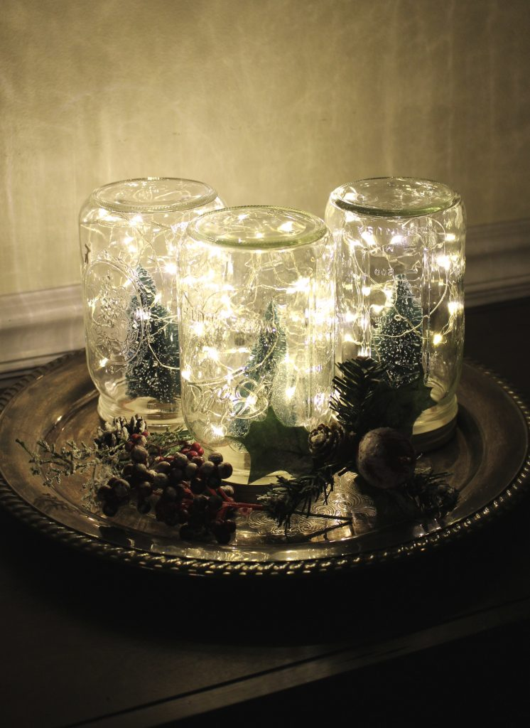 Mason jar craft- twinkly lights- fairy lights- bristle bottle trees- Hobby Lobby- seasonal decor- winter- Christmas- diy- diy project- diy craft- rustic home decor- painted projects- home decor- snow village- twinkle jars- battery operated lights