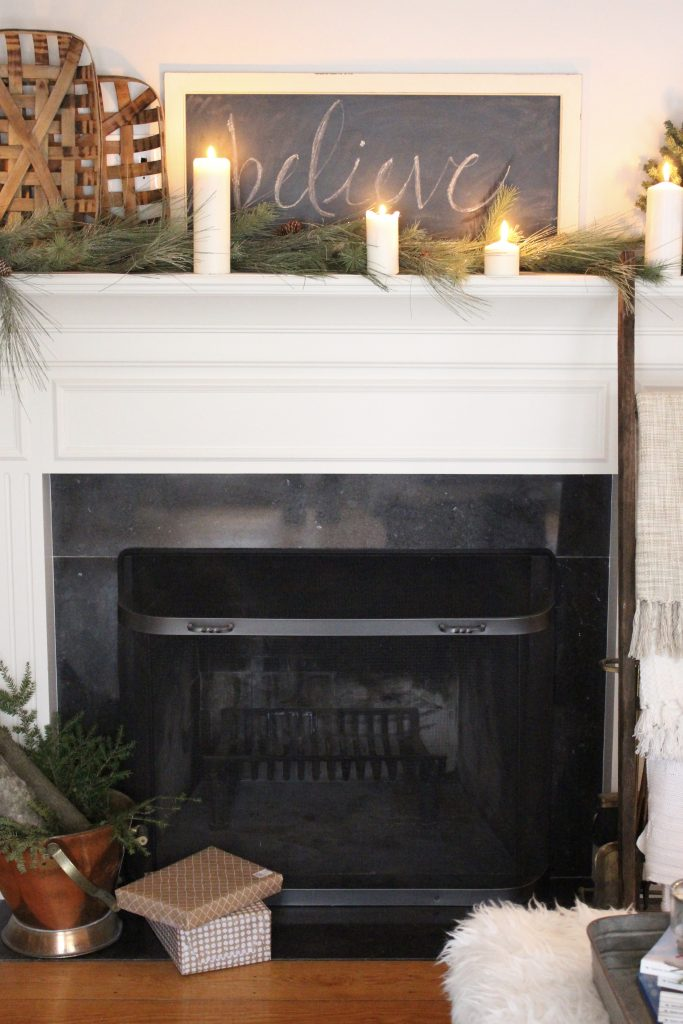 A farmhouse christmas mantel dressed in candlelight my life from home a farmhouse christmas mantel dressed in candlelight home decor holiday mantel decor solutioingenieria Gallery
