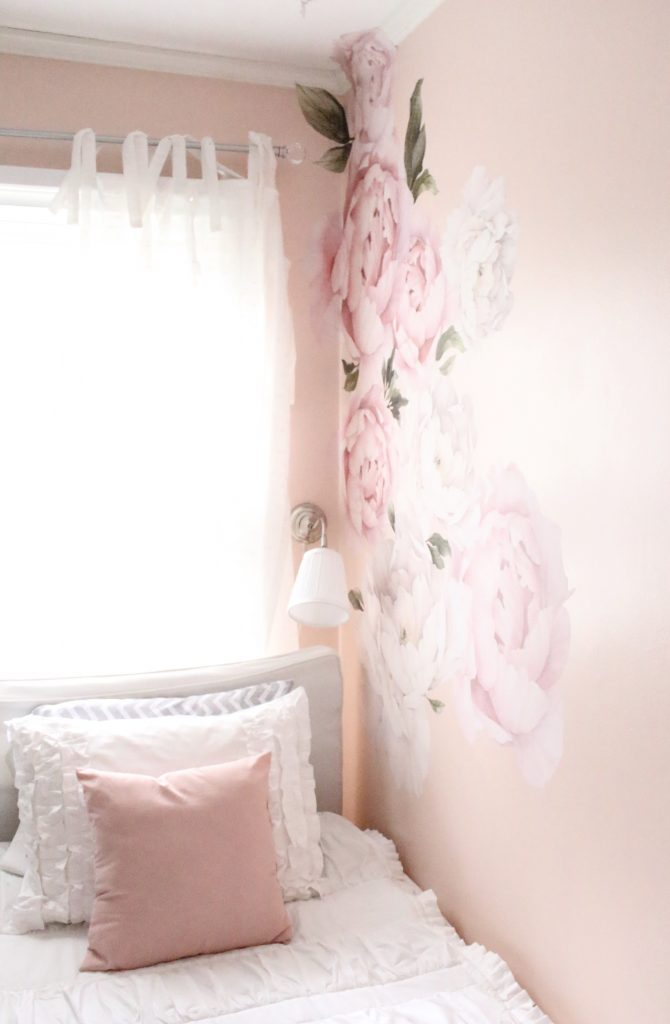 Sweet & Feminine Tween Girl bedroom space- kids bedrooms- girl bedrooms- flower wall decals- white ruffled bedding- pink room- home design- home decor- wall decor ideas- bedroom decor ideas- white bedding- peony wall paper