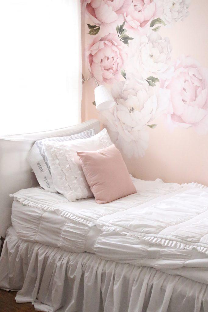 Sweet & Feminine Tween Girl bedroom space- kids bedrooms- girl bedrooms- flower wall decals- white ruffled bedding- pink room- home design- home decor- wall decor ideas- bedroom decor ideas- white bedding- peony wall paper- flower wallpaper decals- blush walls- Beddy's bedding- zip up bedding