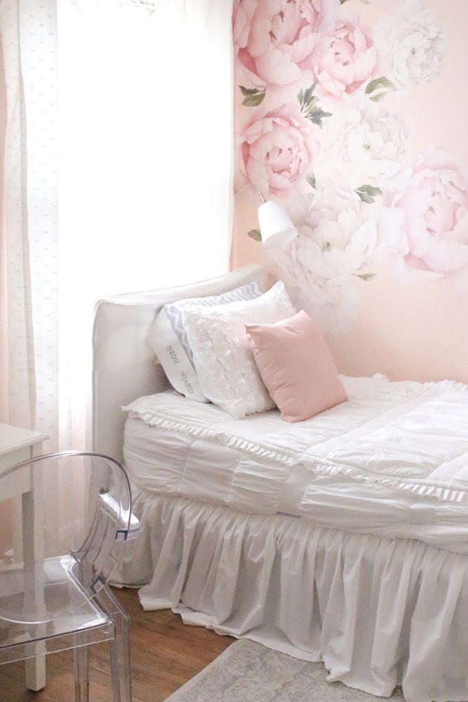 Sweet & Feminine Tween Girl bedroom space- kids bedrooms- girl bedrooms- flower wall decals- white ruffled bedding- pink room- home design- home decor- wall decor ideas- bedroom decor ideas- white bedding- peony wall paper- flower wallpaper decals- blush walls- Beddy's bedding- zip up bedding- pink and gray