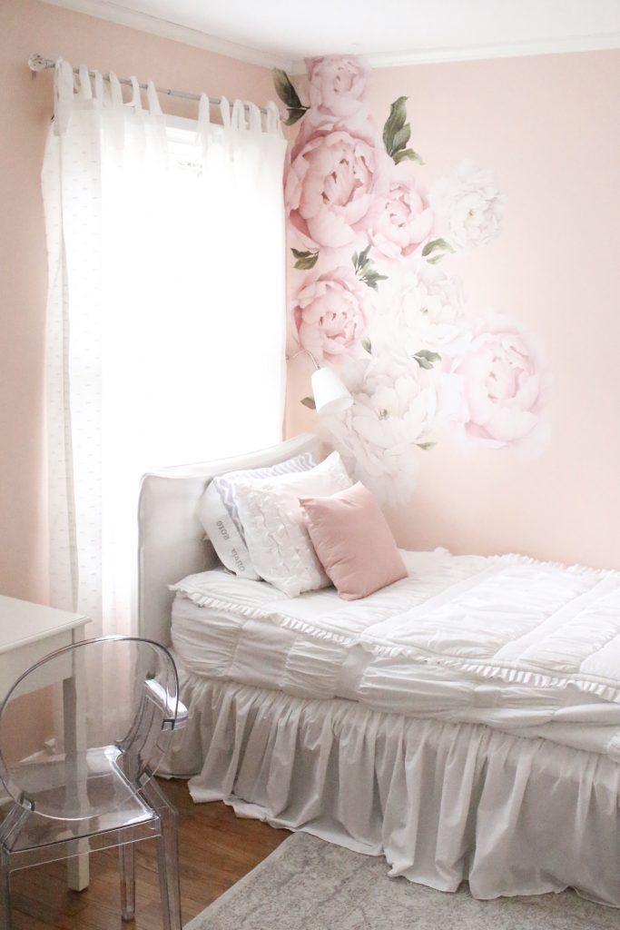 Sweet & Feminine Tween Girl bedroom space- kids bedrooms- girl bedrooms- flower wall decals- white ruffled bedding- pink room- home design- home decor- wall decor ideas- bedroom decor ideas- white bedding- peony wall paper- flower wallpaper decals- blush walls- Beddy's bedding- zip up bedding- pink and gray- removable wall decals- teen bedroom- clear chair