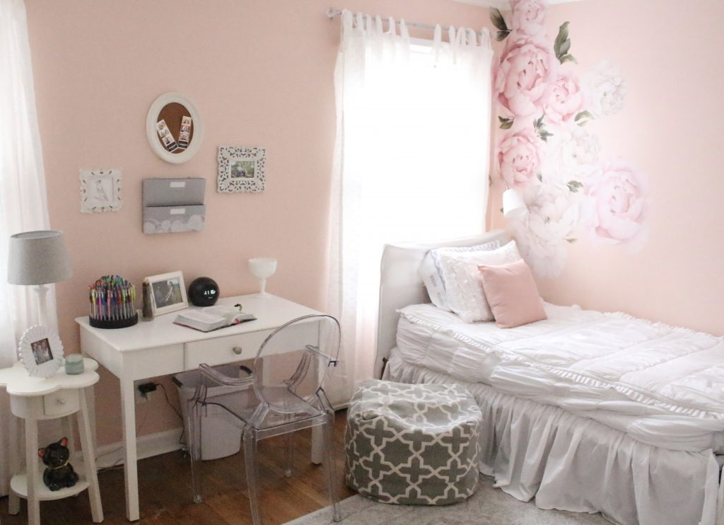 Sweet & Feminine Tween Girl bedroom space- kids bedrooms- girl bedrooms- flower wall decals- white ruffled bedding- pink room- home design- home decor- wall decor ideas- bedroom decor ideas- white bedding- peony wall paper- flower wallpaper decals- blush walls- Beddy's bedding- zip up bedding- pink and gray- removable wall decals- teen bedroom- desk organization