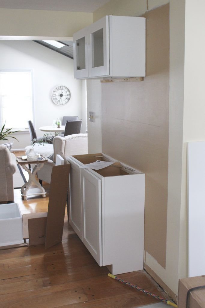 Warm and Inviting White Cottage Kitchen Renovation Update- Halfway mark of the kitchen reno- white and gray kitchen cabinets- home design- farmhouse sink- hutch- Woodmark- Home Depot cabinets- DIY- DIY projects- renovations- home design ideas- built in hutch- coffee bar