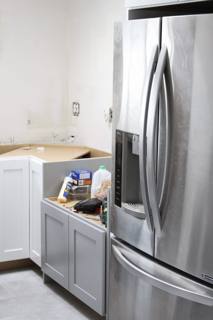 Warm and Inviting White Cottage Kitchen Renovation Update- Halfway mark of the kitchen reno- white and gray kitchen cabinets- home design- farmhouse sink- hutch- Woodmark- Home Depot cabinets- DIY- DIY projects- renovations- home design ideas- redesigned kitchen