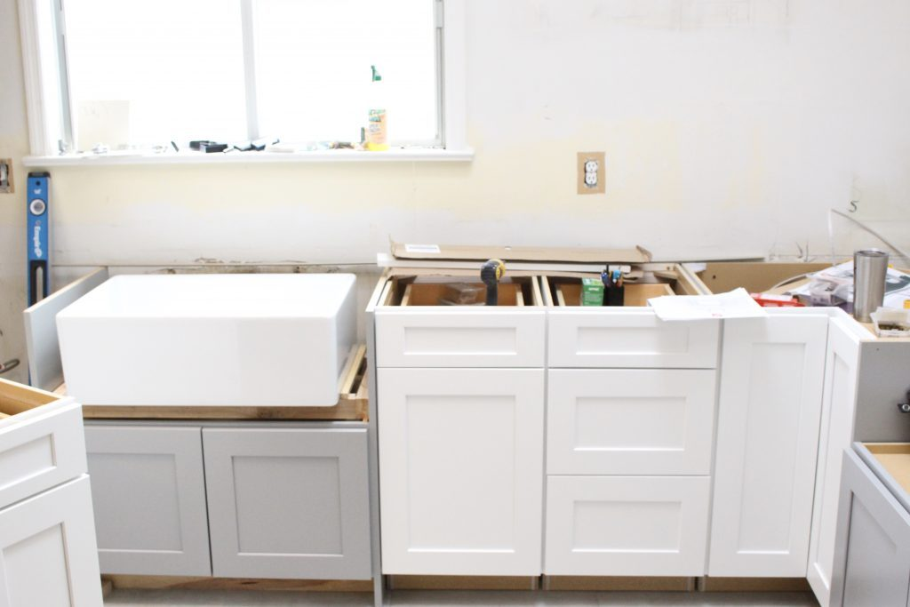 Warm and Inviting White Cottage Kitchen Renovation Update- Halfway mark of the kitchen reno- white and gray kitchen cabinets- home design- farmhouse sink- hutch- Woodmark- Home Depot cabinets- DIY- DIY projects- renovations- home design ideas